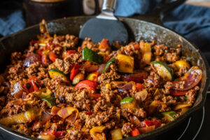 Beef and vegetable stir fry in a pan