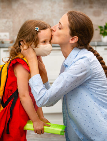 Child being welcomed home from school in kitchen