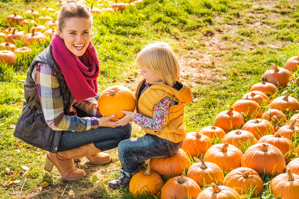 Mother and daughter in pumpkin patch