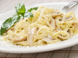 Fettuccine Alfredo dish on a table.