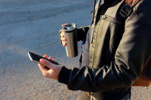 Guy holding a stainless steel coffee mug