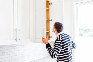 Man checking empty cabinet space
